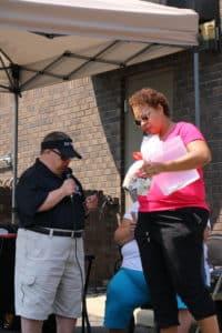 Ludie Jones and DJ Ron giving away door prizes
